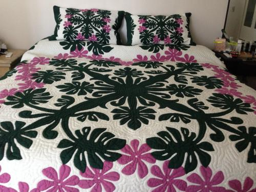 Mary's Quilt (Monstera-Tiare flowers)